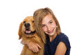 Teen girl with her golden retriever dog a teenage wearing headgear sits Stock Image