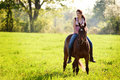 Teen girl on her horse Royalty Free Stock Photo