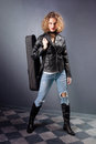Teen girl with her violin in leather jacket and blue jeans studio shot Stock Photo