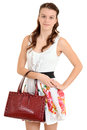 Teen girl holding a purse Royalty Free Stock Photo