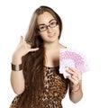 Teen girl holds money in a fan-shape