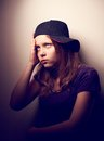 Teen girl ignoring someone depressed mad in cap Stock Photos