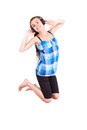 Teen girl jumping for joy on white background Royalty Free Stock Photo