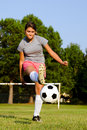Teen girl kicking soccer ball Royalty Free Stock Photography