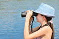 Teen girl looking through binoculars side view horizontal Royalty Free Stock Photography