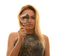 Teen girl with magnifying glass