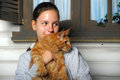 Teen girl with maine coon a six month kitten on hands Royalty Free Stock Images