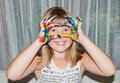 Teen girl makes love mask by fingers on her face Royalty Free Stock Photo