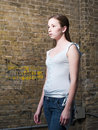 Teen girl near brick wall Royalty Free Stock Image
