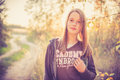 Teen girl near road posing at sunset warm light Royalty Free Stock Images