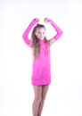 Teen girl in a pink dress posing Stock Photos