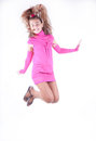Teen girl in a pink dress posing Stock Images