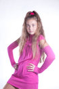 Teen girl in a pink dress posing Royalty Free Stock Image