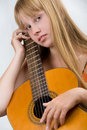 Teen girl playing guitar Royalty Free Stock Photography