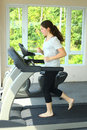 Teen girl with pony tail jogging on treadmill Royalty Free Stock Photo