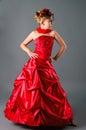 Teen girl posing in prom dress in studio Royalty Free Stock Photo