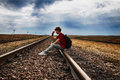 Teen girl with problems sitting on rail road sittingon old Royalty Free Stock Photo