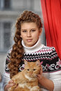 Teen girl with a red cat Royalty Free Stock Photo