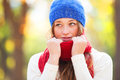 Teen girl in red scarf at autumn outdoor Stock Photos