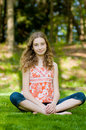 Teen girl relaxing outdoors Royalty Free Stock Photography