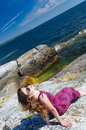 Teen girl relaxing on a sea coast teenager swedish sunny Stock Photo