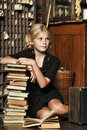 Teen girl  in retro style with a stack of books Royalty Free Stock Photo