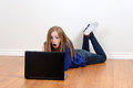Teen girl shocked using laptop Royalty Free Stock Photo
