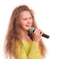 Teen girl singing with a microphone in her hand portrait isolated on white background Stock Photos
