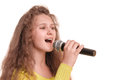 Teen girl singing with a microphone in her hand portrait isolated on white background Stock Photography