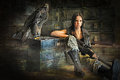 Teen girl sitting with a rifle Royalty Free Stock Photo
