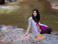 Teen girl sitting by river in thailand biracial next to smiling Stock Photos