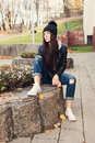 Teen girl sitting on stairs against grunge wall portrait of a beautiful hipster outdoors lifestyle Royalty Free Stock Photo