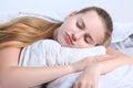 Teen girl sleeps lying on a pillow Royalty Free Stock Photo