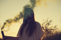 Teen girl with smoke bomb Royalty Free Stock Photo