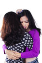 Teen girl soothe her friend two friends hugging in the studio while soothing each other isolated on white Royalty Free Stock Photos