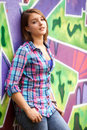 Teen girl standing near graffiti wall. Royalty Free Stock Photos