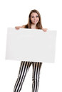Teen girl with stripe pants holding blank sign isolated Royalty Free Stock Images