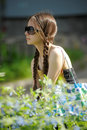Teen girl in sunglasses with pigtails Stock Photo