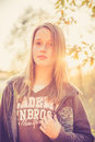 Teen girl at sunset in casual cloth in autumn or fall nature is posing Stock Photos