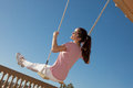 Teen girl on swing happy smiling Stock Photos