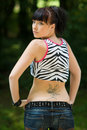 Teen girl with tattoo Royalty Free Stock Photo
