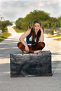 Teen Girl on a Trunk in the Street (3) Stock Images