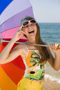 Teen girl with umbrella on seashore Royalty Free Stock Photo