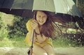 Teen girl under the big umbrella in a downpour Royalty Free Stock Photo