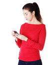 Teen girl using cell phone Royalty Free Stock Photo