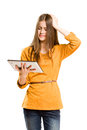 Teen girl using tablet computer. Stock Photos