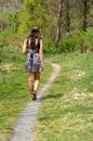 Teen girl walking on a path Stock Image