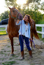 A teen girl walks with her horse Royalty Free Stock Photo