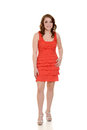 Teen girl wearing orange dress on white background Royalty Free Stock Photography