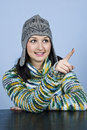Teen girl in winter clothes pointing Royalty Free Stock Photo